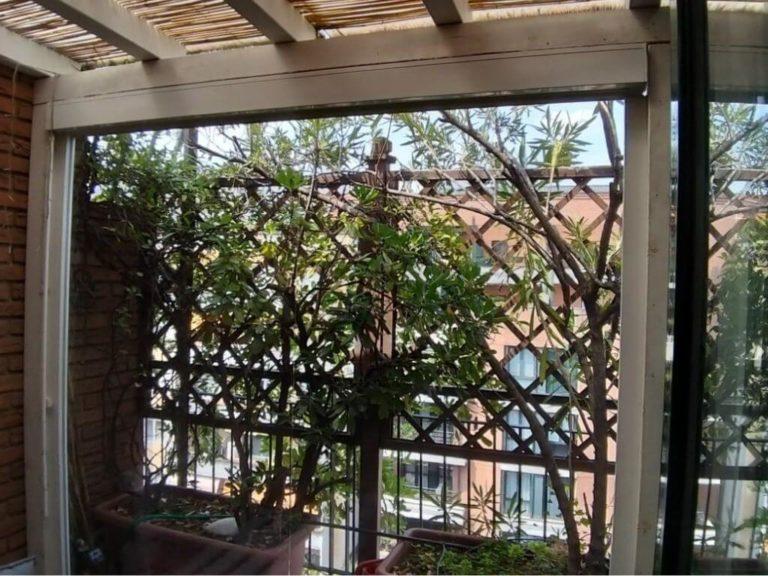 Chiusura veranda con tende cristal a Milano - 1